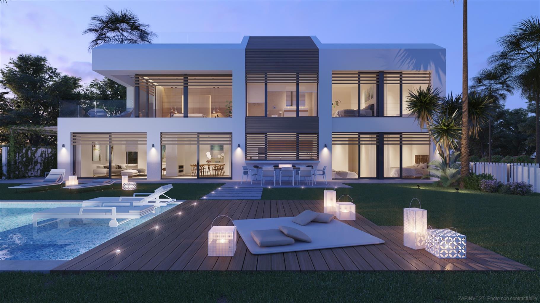 Villa de luxe, innovante et spectaculaire, de cinq chambres, piscine extérieure, intérieure et jacuzzi, ascenseur, barbecue et en première ligne de mer.